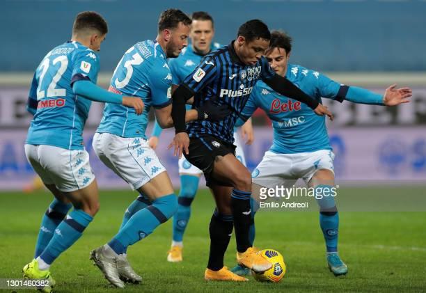 Luis Muriel of Atalanta is challenged by Giovanni Di Lorenzo, Amir Rrahmani and Eljif Elmas of Napoli during the Coppa Italia match between Atalanta...