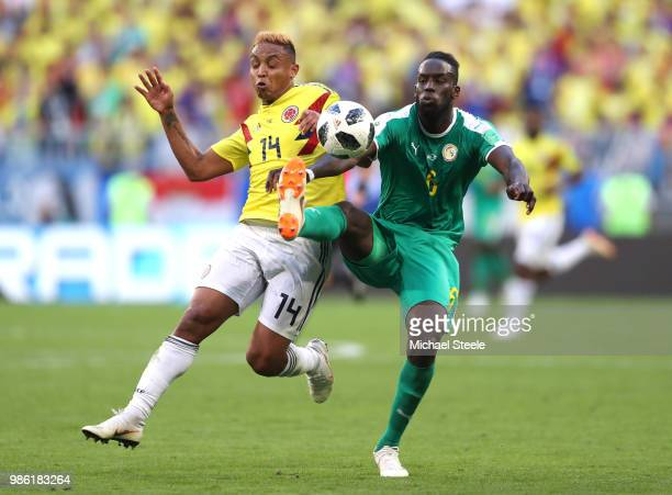 Luis Muriel of Colombia battles for possession with Salif Sane of Senegal during the 2018 FIFA World Cup Russia group H match between Senegal and...