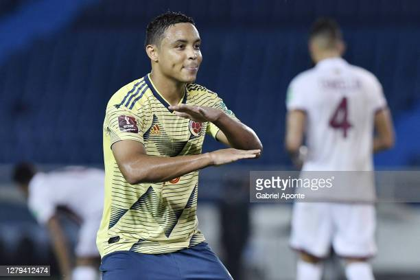 Luis Muriel of Colombia celebrates after scoring the second goal of his team during a match between Colombia and Venezuela as part of South American...