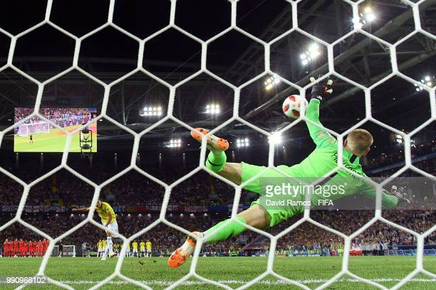 Luis Muriel of Colombia scores past Jordan Pickford of England his team's third penalty in the penalty shoot out during the 2018 FIFA World Cup...