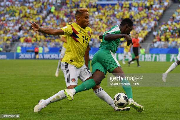 Luis Muriel of Colombia tackles Ismaila Sarr of Senegal during the 2018 FIFA World Cup Russia group H match between Senegal and Colombia at Samara...
