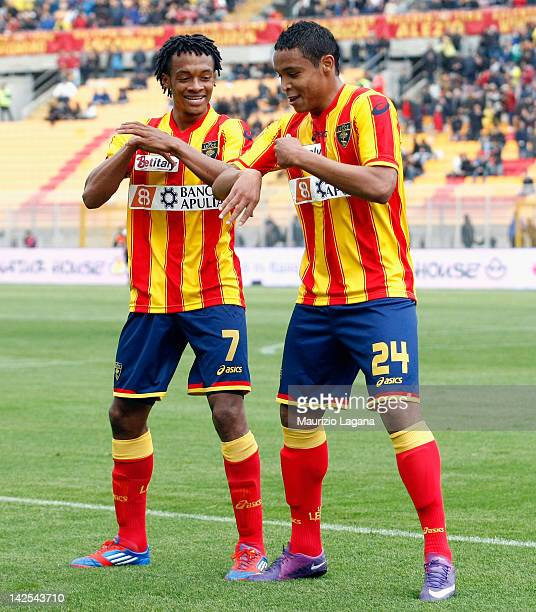 Luis Muriel of Lecce celebrates with his team-mate Juan Cuadrado after scoring opening goal during the Serie A match between US Lecce and AS Roma at...