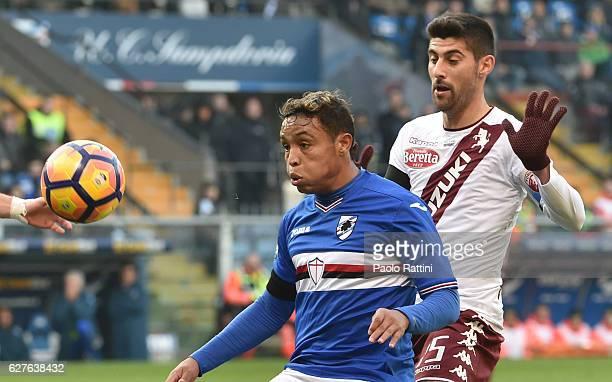 Luis Muriel of Sampdoria in action against Marco Benassi of Torino during the Serie A match between UC Sampdoria and FC Torino at Stadio Luigi...