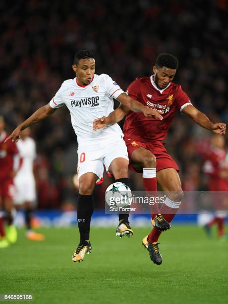 Luis Muriel of Sevilla and Joe Gomez of Liverpool battle for possession during the UEFA Champions League group E match between Liverpool FC and...