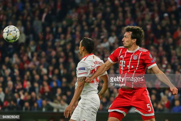 Luis Muriel of Sevilla and Mats Hummels of Muenchen battle for the ball during the UEFA Champions League quarter final second leg match between...
