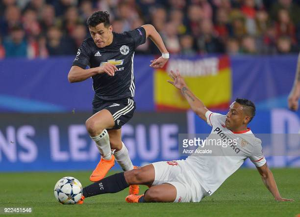 Luis Muriel of Sevilla battles Alexis Sanchez of Manchester United during the UEFA Champions League Round of 16 First Leg match between Sevilla FC...