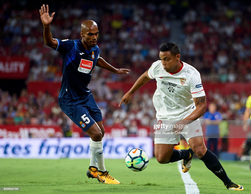 Luis Muriel of Sevilla FC (R) being followed by Mario Hermoso of RCD Espanyol (L) during the La Liga match between Sevilla and Espanyol at on August 19, 2017 in Seville, .
