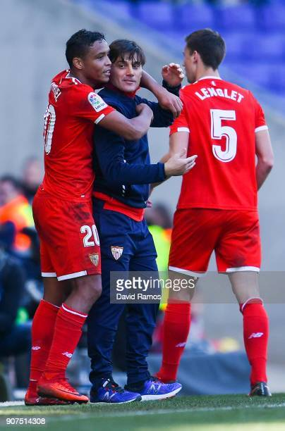 Luis Muriel of Sevilla FC celebrates with Head coach Vicenzo Montella of Sevilla FC after scoring his team's third goal during the La Liga match...