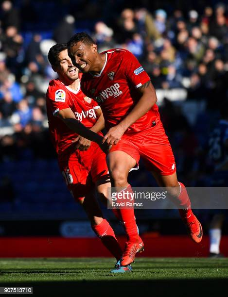 Luis Muriel of Sevilla FC celebrates with his team mate Jesus Navas after scoring his team's third goal during the La Liga match between Espanyol and...