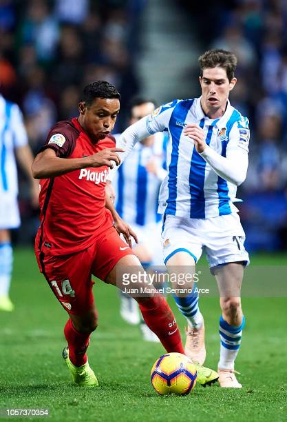 Luis Muriel of Sevilla FC duels for the ball with Aritz Elustondo of Real Sociedad during the La Liga match between Real Sociedad and Sevilla FC at...