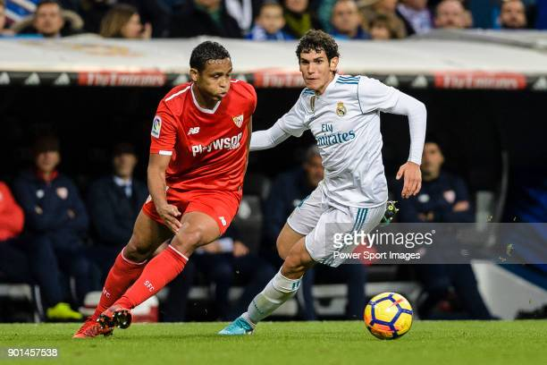 Luis Muriel of Sevilla FC fights for the ball with Jesus Vallejo of Real Madrid during La Liga 201718 match between Real Madrid and Sevilla FC at...