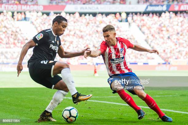 Luis Muriel of Sevilla FC fights for the ball with Lucas Hernandez of Atletico de Madrid during the La Liga 201718 match between Atletico de Madrid...