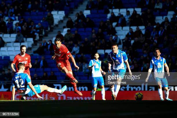 Luis Muriel of Sevilla FC scores his team's third goal during the La Liga match between Espanyol and Sevilla at Nuevo Estadio de CornellaEl Prat on...