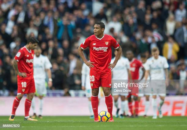 Luis Muriel of Sevilla reacts after Real Madrid scored their 3rd goal during the La Liga match between Real Madrid and Sevilla at Estadio Santiago...