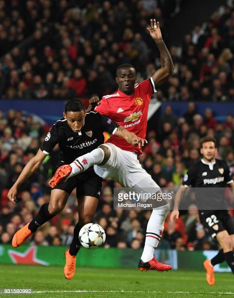 Luis Muriel of Sevilla under pressure from Eric Bailly of Manchester United during the UEFA Champions League Round of 16 Second Leg match between...