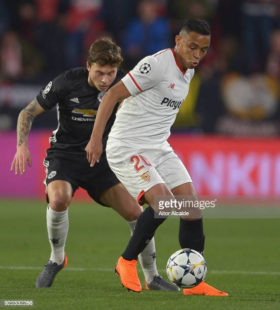 Luis Muriel of Seville in action with Victor Lindelof of Manchester United during the UEFA Champions League Round of 16 First Leg match between...