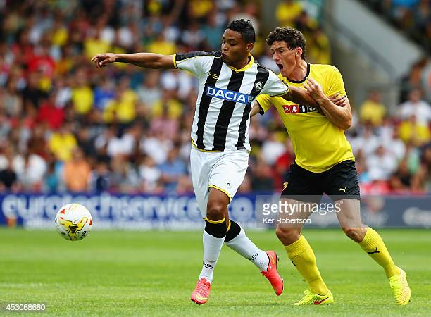 Luis Muriel of Udinese and Keith Andrews of Watford challenge for the ball during the preseason friendly between Watford and Udinese at Vicarage Road...