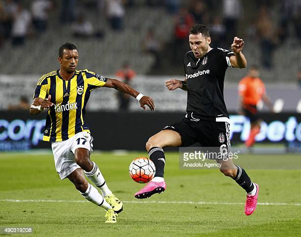 Luis Nani of Fenerbahce vies with Dusko Tosic of Besiktas during the Turkish Spor Toto Super League match between Besiktas and Fenerbahce at Ataturk...