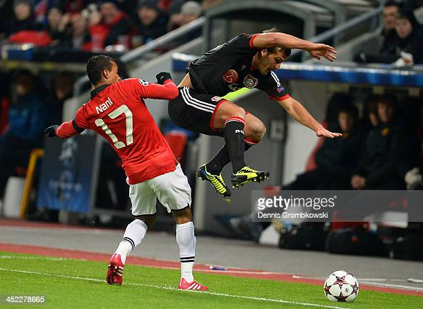 Luis Nani of Manchester United and Giulio Donati of Bayer Leverkusen compete for the ball during the UEFA Champions League Group A match between...