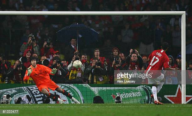 Luis Nani of Manchester United beats Petr Cech of Chelsea as he scores a penalty in the shoot out during the UEFA Champions League Final match...