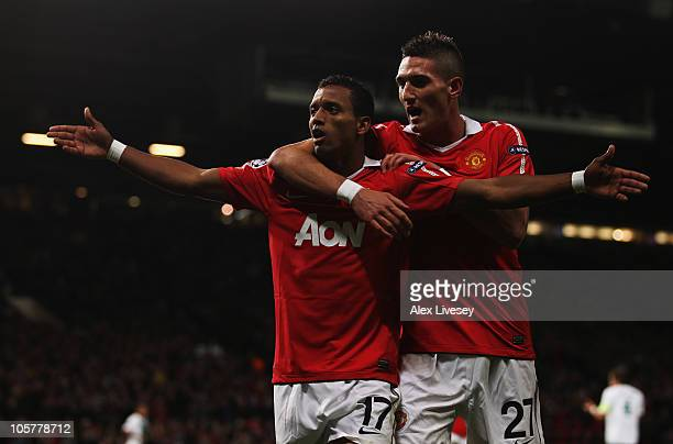 Luis Nani of Manchester United celebrates with Federico Macheda as he scores their first goal during the UEFA Champions League Group C match between...