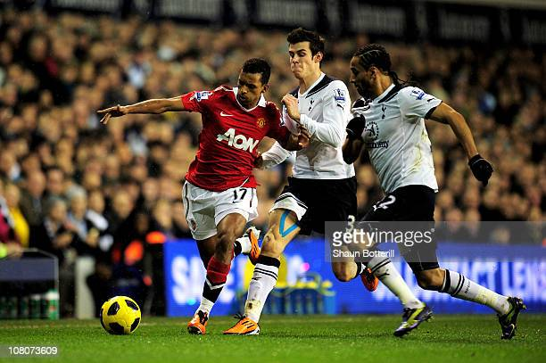 Luis Nani of Manchester United is challenged by Gareth Bale and Benoit AssouEkotto of Spurs during the Barclays Premier League match between...