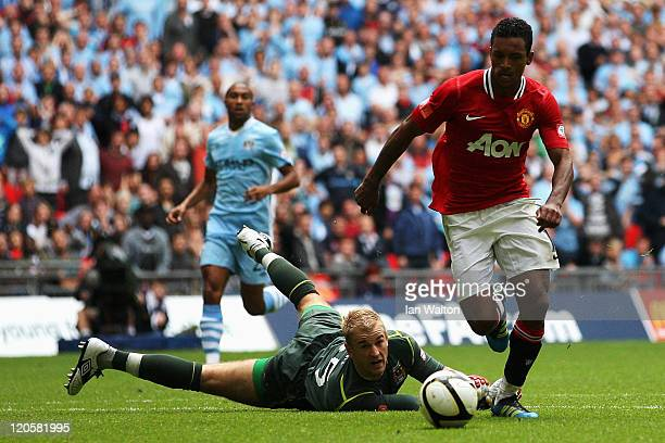 Luis Nani of Manchester United rounds goalkeeper Joe Hart of Manchester City to score their third and winning goal during the FA Community Shield...