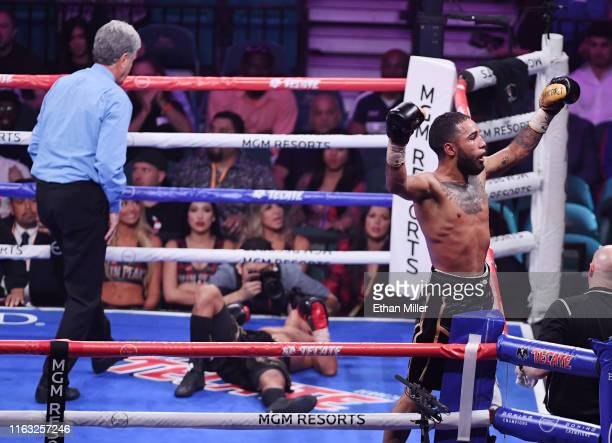 Luis Nery celebrates his ninth-round knockout victory over Juan Carlo Payano in their bantamweight bout as referee Vik Drakulich checks on Payano at...