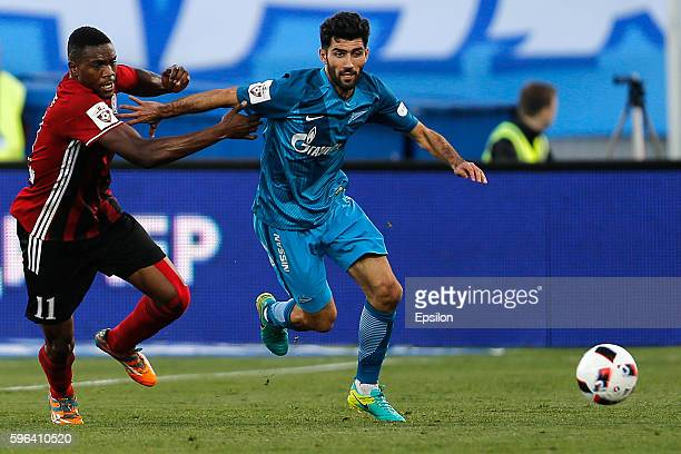 Luis Neto of FC Zenit St Petersburg and Chuma Anene of FC Amkar Perm vie for the ball during the Russian Football League match between FC Zenit St...