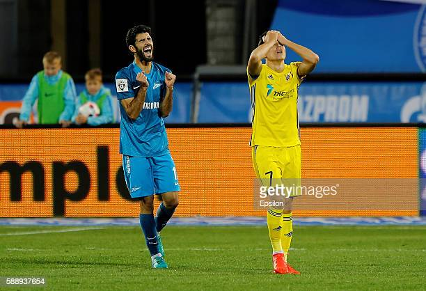 Luis Neto of FC Zenit St Petersburg and Dmitry Poloz of FC Rostov RostovonDon react during the Russian Football League match between FC Zenit St...