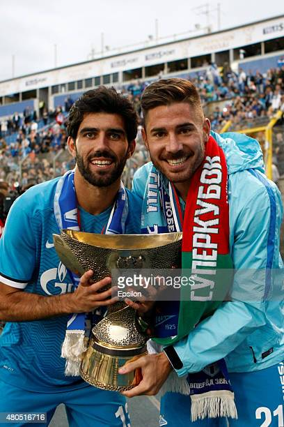 Luis Neto of FC Zenit St Petersburg and Javi Garcia of FC Zenit St Petersburg pose for a photo with the trophy after winning the Super Cup of Russia...