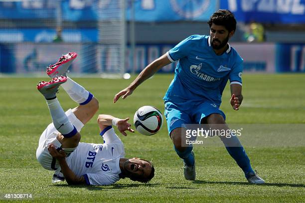 Luis Neto of FC Zenit St Petersburg and Mathieu Valbuena of FC Dinamo Moscow vie for the ball during the Russian Football League match between FC...