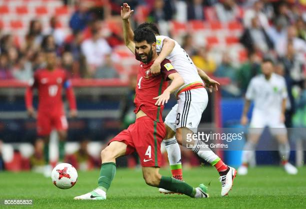 Luis Neto of Portugal and Oribe Peralta of Mexico battle for possession during the FIFA Confederations Cup Russia 2017 PlayOff for Third Place...