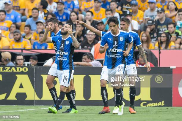Luis Noriega of Queretaro celebrates with teammates after scoring his team's first goal during the 3rd round match between Tigres UANL and Puebla as...