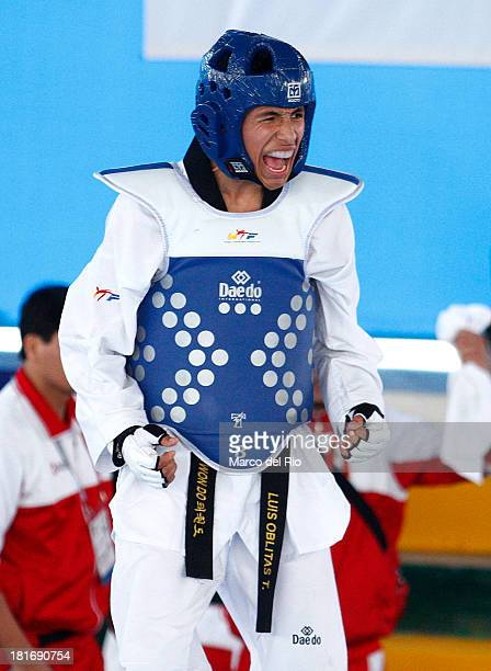 Luis Oblitas of Peru celebrates after defeating Nahuel Perez of Uruguay in Men´s 63 kg Taekwondo Qualifiers as part of the I ODESUR South American...