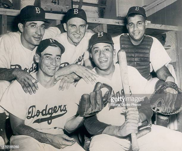 Luis Olmo after making a great catch to beat the Cardinals posing with other Brooklyn Dodgers Carl Furillo Gil HodgesDon Newcombe and Roy Campanella