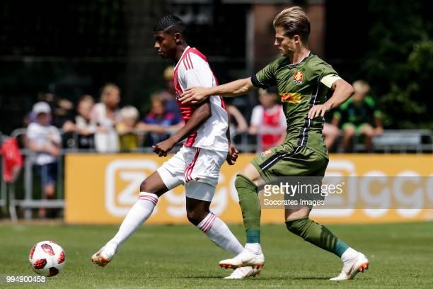 Luis Orejuela of Ajax Mathias Jensen of FC Nordsj¾lland during the Club Friendly match between Ajax v FC Nordsjaelland at the Sportpark Putter Eng on...
