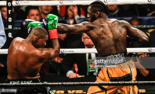Luis Ortiz and Deontay Wilder fight during their WBC Heavyweight Championship fight at Barclays Center on March 3 2018 in the Brooklyn Borough of New...
