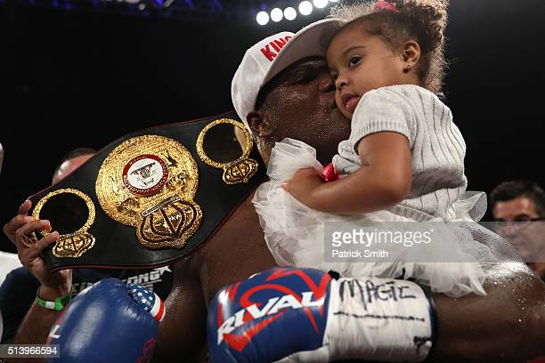 Luis Ortiz celebrates with his daughter Lauria after defeating Tony Thompson in their main event heavyweight match at the DC Armory on March 5 2016...
