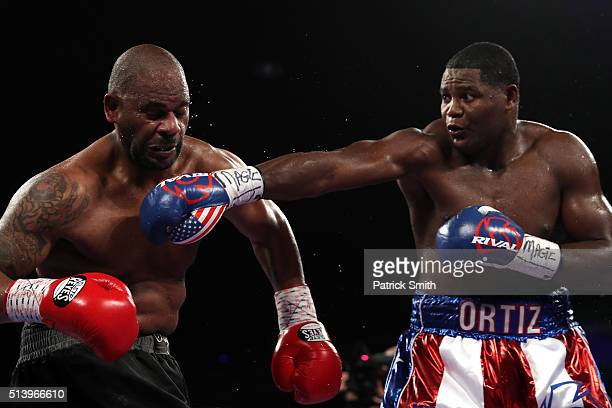 Luis Ortiz exchanges punches with Tony Thompson in their main event heavyweight match at the DC Armory on March 5 2016 in Washington DC