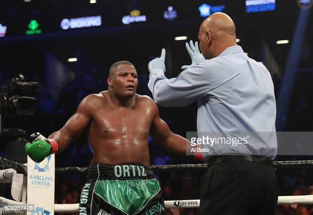 Luis Ortiz gets a standing eight count after being knocked down in the fifth round during his WBC Heavyweight Championship fight against Deontay...