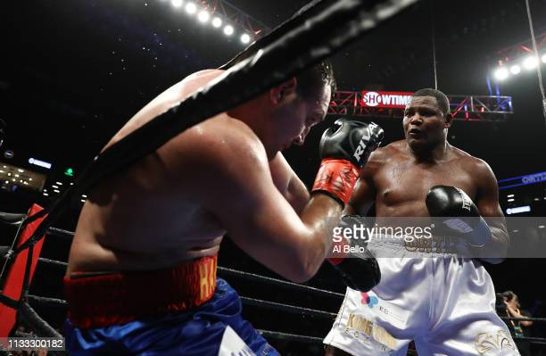 Luis Ortiz knocks Christian Hammer into the ropes during their heavyweight fightat Barclays Center on March 02 2019 in New York City