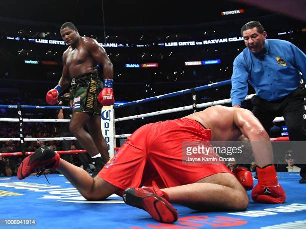 Luis Ortiz of Cuba knocks out Razvan Cojanu of Romania in the second round of their Heavyweight fight at Staples Center on July 28 2018 in Los...