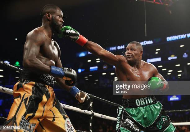 Luis Ortiz punches Deontay Wilder during their WBC Heavyweight Championship fight at Barclays Center on March 3 2018 in the Brooklyn Borough of New...