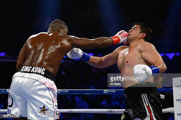 Luis Ortiz punches Matias Ariel Vidondo during their WBA Interim Heavyweight title fight at Madison Square Garden on October 17 2015 in New York City