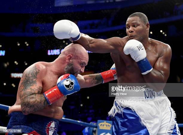 Luis Ortiz punches Travis Kauffman in a 10th round Ortiz knoockout win during a heavyweight bout at Staples Center on December 1 2018 in Los Angeles...