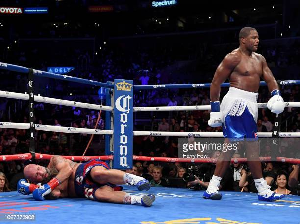 Luis Ortiz walk away after a knock down of Travis Kauffman on his way to a 10th round knoockout win during a heavyweight bout at Staples Center on...