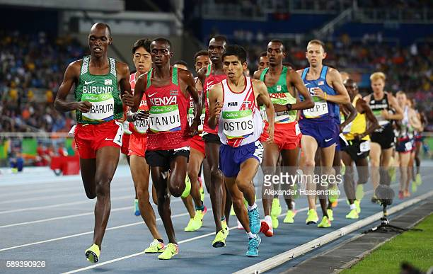 Luis Ostos of Peru Paul Kipngetich Tanui of Kenya and Olivier Irabaruta of Burundi compete during the Men's 10000m on Day 8 of the Rio 2016 Olympic...