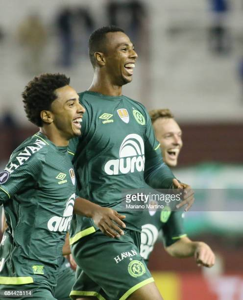 Luis Otavio of Chapecoense celebrates with teammates after scoring the second goal of his team during a group stage match between Lanus and...