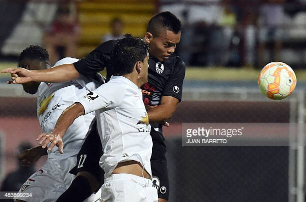 Luis Ovalle of Venezuela's Zamora vies for ball with Norberto Araujo of Ecuador's Liga de Quito during their Copa Sudamericana 2015 football match...